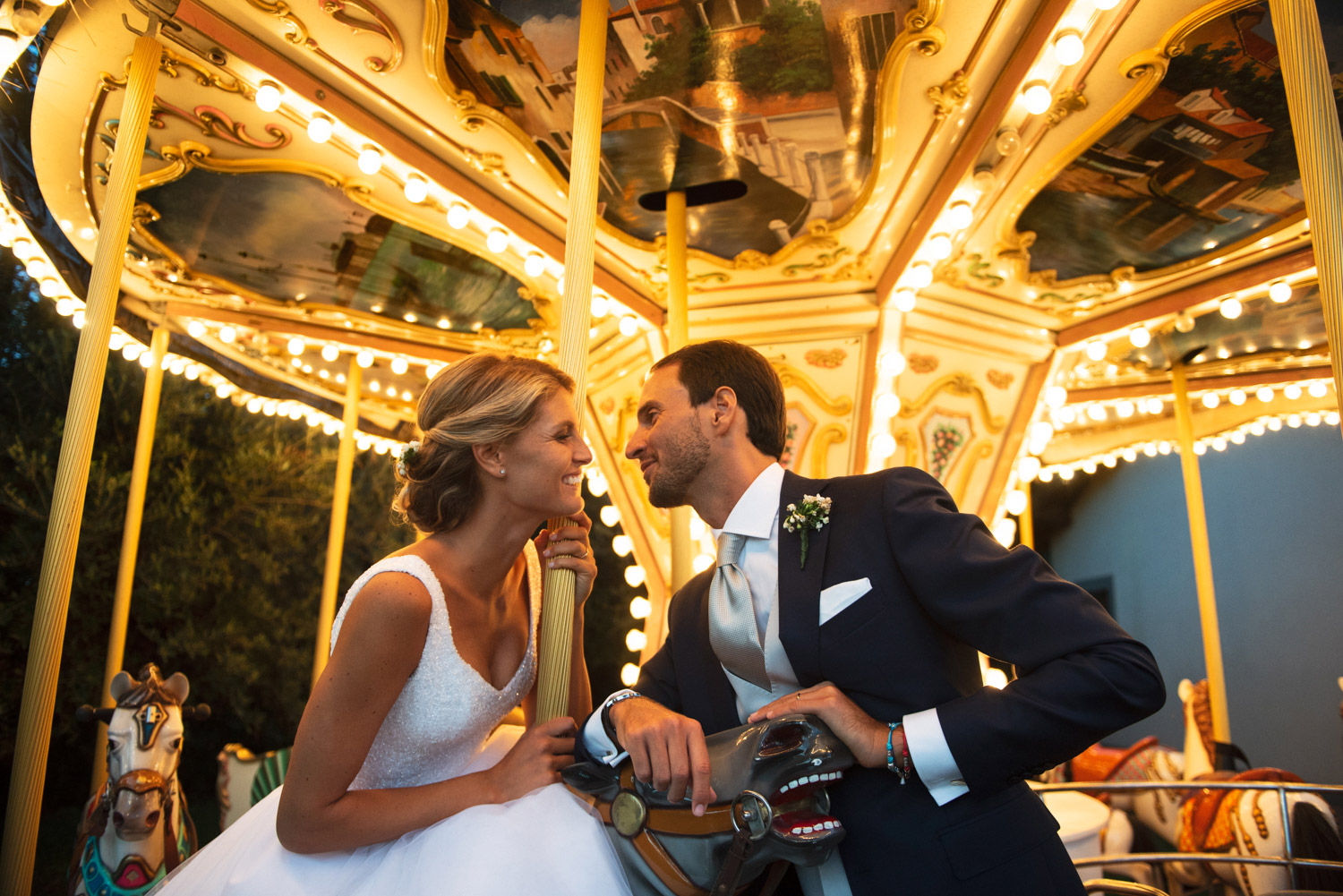 caouple portrait with carousel